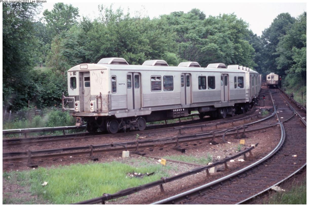 (385k, 1220x817)<br><b>Country:</b> United States<br><b>City:</b> Philadelphia, PA<br><b>System:</b> SEPTA (or Predecessor)<br><b>Line:</b> Market-Frankford El<br><b>Location:</b> 69th Street<br><b>Car:</b> SEPTA M-3 (Budd, 1960) 841 <br><b>Photo by:</b> Lee Winson<br><b>Date:</b> 6/1976<br><b>Notes:</b> Tiny stretch of woods near station. Shows the overruning third rail used on Mkt-Fkd Line.<br><b>Viewed (this week/total):</b> 4 / 43