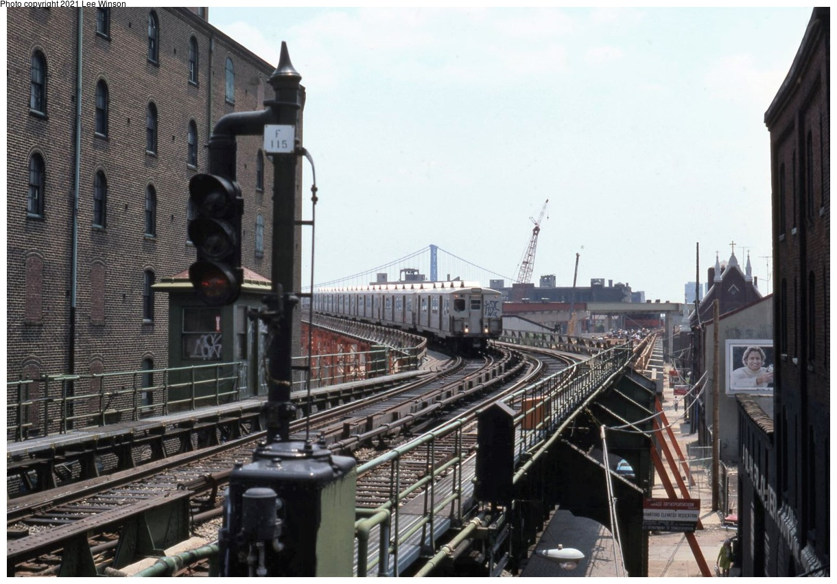 (378k, 1220x851)<br><b>Country:</b> United States<br><b>City:</b> Philadelphia, PA<br><b>System:</b> SEPTA (or Predecessor)<br><b>Line:</b> Market-Frankford El<br><b>Location:</b> Girard<br><b>Photo by:</b> Lee Winson<br><b>Date:</b> 6/1976<br><b>Notes:</b> Temporary bypass trackage for I-95 construction. Signal tower in background controlled turnback track; tower has been removed since.<br><b>Viewed (this week/total):</b> 3 / 39