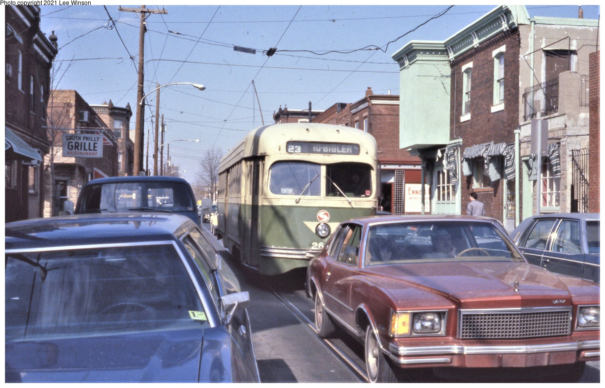 (360k, 1220x783)<br><b>Country:</b> United States<br><b>City:</b> Philadelphia, PA<br><b>System:</b> SEPTA (or Predecessor)<br><b>Line:</b> Rt. 23-Germantown<br><b>Location:</b> 12th/Snyder<br><b>Car:</b> PTC/SEPTA Wartime Air-car PCC (St.Louis, 1942) 2647 <br><b>Photo by:</b> Lee Winson<br><b>Date:</b> 3/1982<br><b>Notes:</b> Southbound at 12th & Mercy Streets, (approaching Snyder Ave). Many Philadelphia trolleys had to snake through narrow congested streets like this. Note old style block letters on rollsign, before Helvetica typeface.<br><b>Viewed (this week/total):</b> 4 / 39