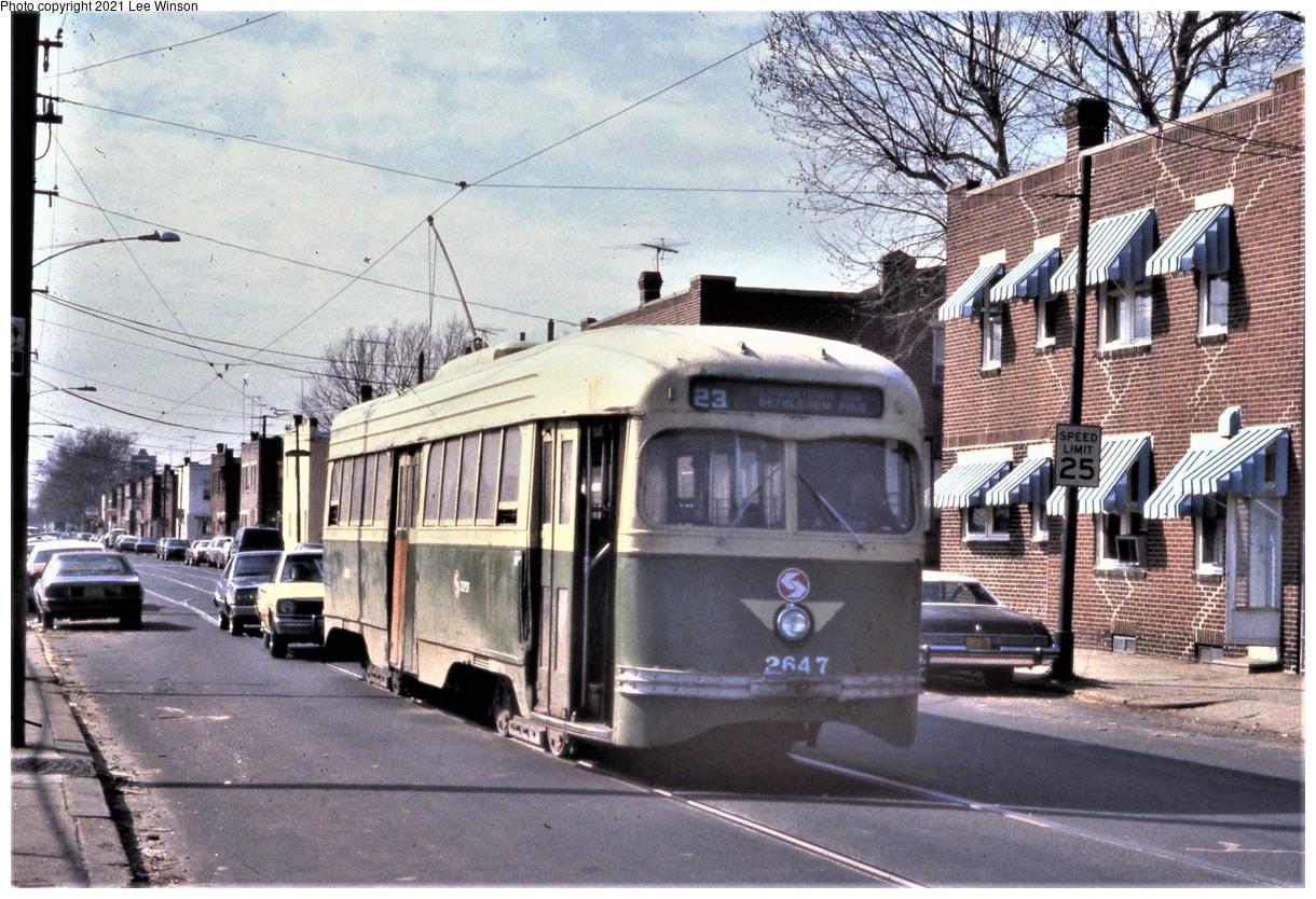 (491k, 1220x834)<br><b>Country:</b> United States<br><b>City:</b> Philadelphia, PA<br><b>System:</b> SEPTA (or Predecessor)<br><b>Line:</b> Rt. 23-Germantown<br><b>Location:</b> 10th/Bigler<br><b>Car:</b> PTC/SEPTA Wartime Air-car PCC (St.Louis, 1942) 2647 <br><b>Photo by:</b> Lee Winson<br><b>Date:</b> 3/1982<br><b>Notes:</b> Simplified paint scheme eliminated belt rail stripe.<br><b>Viewed (this week/total):</b> 6 / 42