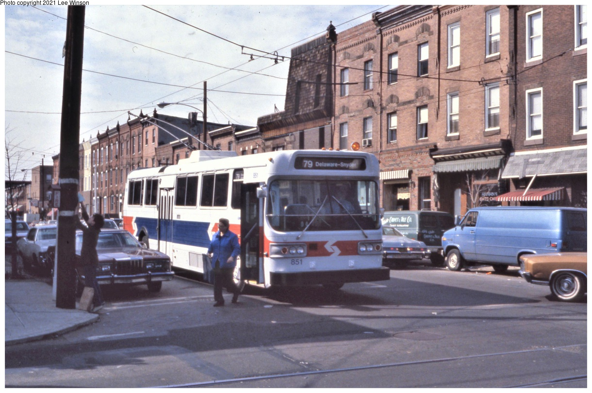 (336k, 1220x811)<br><b>Country:</b> United States<br><b>City:</b> Philadelphia, PA<br><b>System:</b> SEPTA (or Predecessor)<br><b>Line:</b> SEPTA Trackless Trolley Routes<br><b>Route:</b> Rt 79<br><b>Car:</b> PTC/SEPTA AM General 10240-E Trackless (1979) 851 <br><b>Photo by:</b> Lee Winson<br><b>Date:</b> 3/1982<br><b>Notes:</b> Eastbound at 12th St & Synder Ave. Note fire alarm callbox at left, now gone.<br><b>Viewed (this week/total):</b> 3 / 36