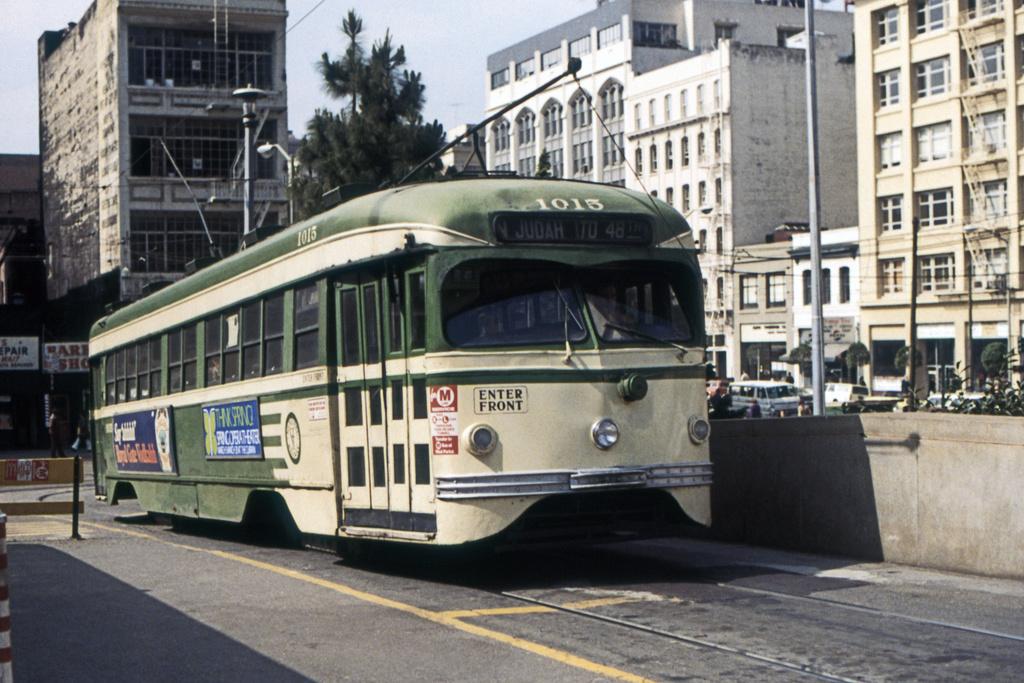 (381k, 1024x683)<br><b>Country:</b> United States<br><b>City:</b> San Francisco/Bay Area, CA<br><b>System:</b> SF MUNI<br><b>Location:</b> Transbay Terminal<br><b>Car:</b> SF MUNI PCC Torpedo Double-End (St. Louis Car Co., 1948) 1015 <br><b>Collection of:</b> David Pirmann<br><b>Date:</b> 3/1974<br><b>Viewed (this week/total):</b> 0 / 14926