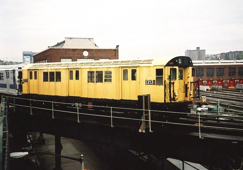 (196k, 800x561)<br><b>Country:</b> United States<br><b>City:</b> New York<br><b>System:</b> New York City Transit<br><b>Location:</b> 207th Street Yard<br><b>Route:</b> Fan Trip<br><b>Car:</b> R-22 (St. Louis, 1957-58) 37371 <br><b>Photo by:</b> Gary Chatterton<br><b>Date:</b> 5/1/2005<br><b>Notes:</b> Work Motor 37371 before fantrip, leaving 207th St. Yard.<br><b>Viewed (this week/total):</b> 1 / 2789