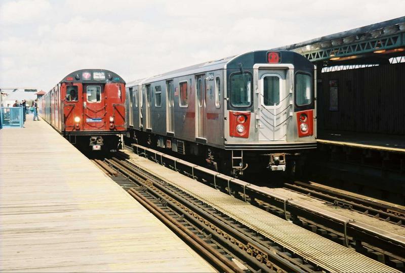 (74k, 800x540)<br><b>Country:</b> United States<br><b>City:</b> New York<br><b>System:</b> New York City Transit<br><b>Line:</b> IRT White Plains Road Line<br><b>Location:</b> 238th Street (Nereid Avenue)<br><b>Route:</b> Fan Trip<br><b>Car:</b> R-33 World's Fair (St. Louis, 1963-64) 9327 <br><b>Photo by:</b> Gary Chatterton<br><b>Date:</b> 5/1/2005<br><b>Notes:</b> With R142 6435<br><b>Viewed (this week/total):</b> 5 / 4953