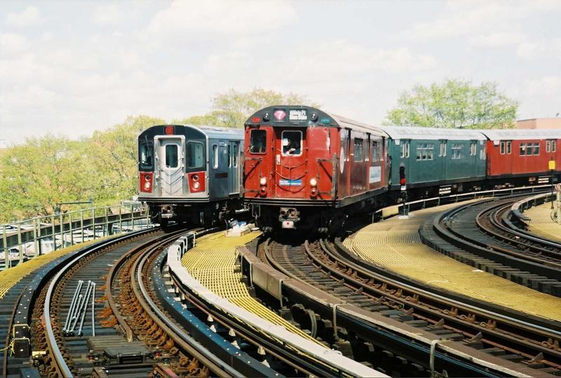 (87k, 800x540)<br><b>Country:</b> United States<br><b>City:</b> New York<br><b>System:</b> New York City Transit<br><b>Line:</b> IRT White Plains Road Line<br><b>Location:</b> West Farms Sq./East Tremont Ave./177th St.<br><b>Route:</b> Fan Trip<br><b>Car:</b> R-33 World's Fair (St. Louis, 1963-64) 9327 <br><b>Photo by:</b> Gary Chatterton<br><b>Date:</b> 5/1/2005<br><b>Notes:</b> With R142 6915.<br><b>Viewed (this week/total):</b> 1 / 3715