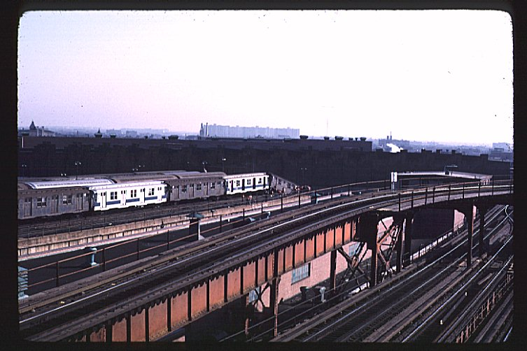 (85k, 753x502)<br><b>Country:</b> United States<br><b>City:</b> New York<br><b>System:</b> New York City Transit<br><b>Location:</b> East New York Yard/Shops<br><b>Car:</b> R-9 (Pressed Steel, 1940) 1761 <br><b>Photo by:</b> Joe Testagrose<br><b>Date:</b> 12/3/1972<br><b>Notes:</b> lead car R9 1761 has overshot the end of the upper level and is hanging off<br><b>Viewed (this week/total):</b> 2 / 6454