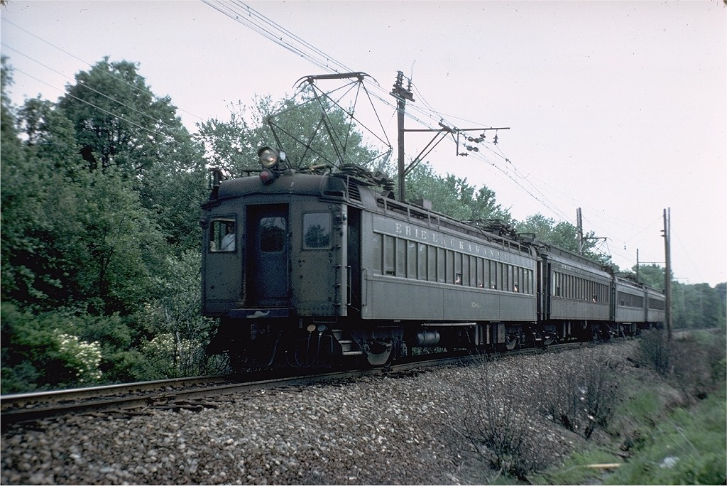 (236k, 1024x684)<br><b>Country:</b> United States<br><b>System:</b> NJ Transit (or Predecessor)<br><b>Line:</b> NJT Morris & Essex Line<br><b>Location:</b> Near Berkeley Hts<br><b>Car:</b> Erie-Lackawanna EMU 3554 <br><b>Photo by:</b> Steve Zabel<br><b>Collection of:</b> Joe Testagrose<br><b>Date:</b> 5/25/1977<br><b>Viewed (this week/total):</b> 1 / 2981