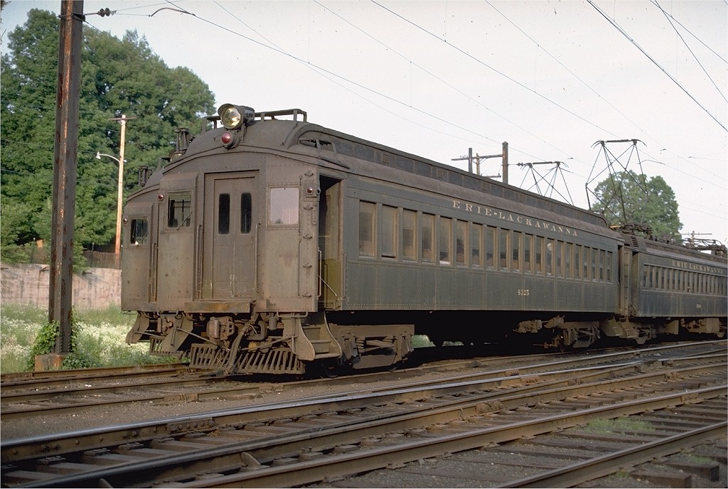 (216k, 1024x688)<br><b>Country:</b> United States<br><b>System:</b> NJ Transit (or Predecessor)<br><b>Line:</b> NJT Morris & Essex Line<br><b>Location:</b> Gladstone<br><b>Car:</b> Erie-Lackawanna EMU 4325 <br><b>Photo by:</b> Ed McKernan<br><b>Collection of:</b> Joe Testagrose<br><b>Date:</b> 6/27/1977<br><b>Viewed (this week/total):</b> 1 / 2772