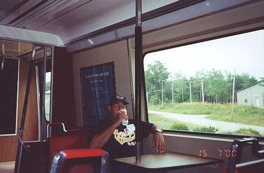 (33k, 531x348)<br><b>Country:</b> United States<br><b>City:</b> Kennebunk, ME<br><b>System:</b> Seashore Trolley Museum<br><b>Car:</b> SOAC  <br><b>Photo by:</b> Thurston Clark<br><b>Date:</b> 7/15/2000<br><b>Notes:</b> SOAC commuter car with Brooklyn customer having his morning coffee while mid-west native looks on<br><b>Viewed (this week/total):</b> 0 / 5740
