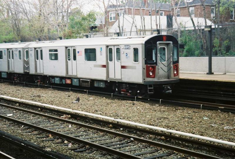 (101k, 800x540)<br><b>Country:</b> United States<br><b>City:</b> New York<br><b>System:</b> New York City Transit<br><b>Line:</b> IRT Dyre Ave. Line<br><b>Location:</b> Gun Hill Road<br><b>Route:</b> 5<br><b>Car:</b> R-142 (Primary Order, Bombardier, 1999-2002) 6915 <br><b>Photo by:</b> Gary Chatterton<br><b>Date:</b> 5/1/2005<br><b>Viewed (this week/total):</b> 1 / 4841