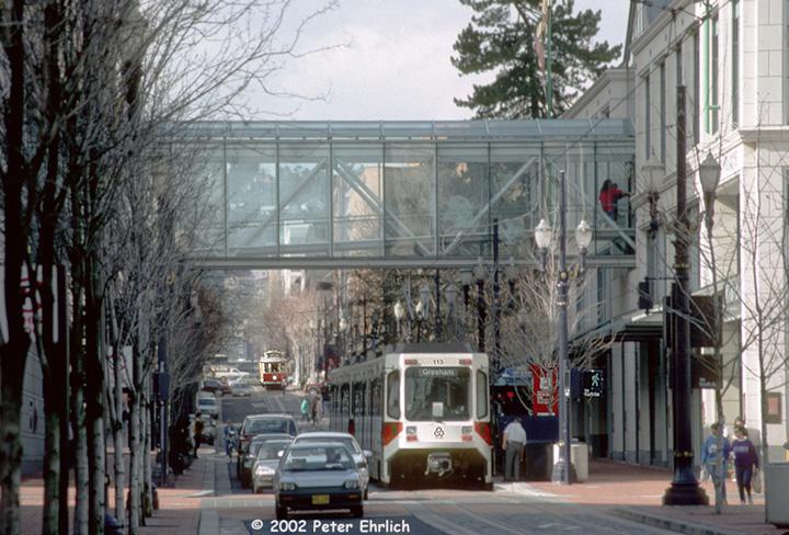 (173k, 720x488)<br><b>Country:</b> United States<br><b>City:</b> Portland, OR<br><b>System:</b> Portland MAX<br><b>Line:</b> MAX Blue (East-West) Line<br><b>Location:</b> SW 4th/Mall<br><b>Car:</b> MAX Type 1 (Bombardier) 113 <br><b>Photo by:</b> Peter Ehrlich<br><b>Date:</b> 2/15/1992<br><b>Notes:</b> Portland Vintage Trolley 511 following.<br><b>Viewed (this week/total):</b> 0 / 2588
