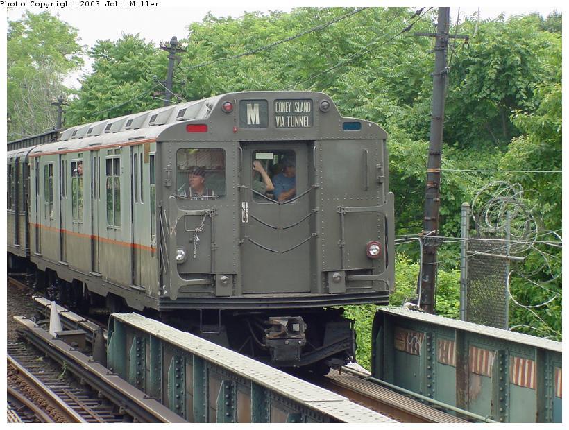 (117k, 820x620)<br><b>Country:</b> United States<br><b>City:</b> New York<br><b>System:</b> New York City Transit<br><b>Line:</b> BMT Myrtle Avenue Line<br><b>Location:</b> Metropolitan Avenue<br><b>Route:</b> Fan Trip<br><b>Car:</b> R-7A (Pullman, 1938) 1575 <br><b>Photo by:</b> John Miller<br><b>Date:</b> 6/28/2003<br><b>Viewed (this week/total):</b> 1 / 4575