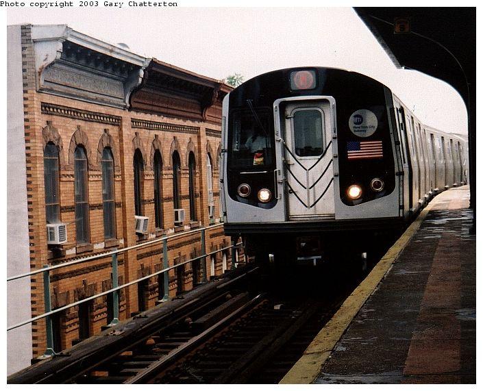 (92k, 705x571)<br><b>Country:</b> United States<br><b>City:</b> New York<br><b>System:</b> New York City Transit<br><b>Line:</b> BMT Myrtle Avenue Line<br><b>Location:</b> Seneca Avenue<br><b>Route:</b> M<br><b>Car:</b> R-143 (Kawasaki, 2001-2002) 8137 <br><b>Photo by:</b> Gary Chatterton<br><b>Date:</b> 6/28/2003<br><b>Viewed (this week/total):</b> 2 / 5890