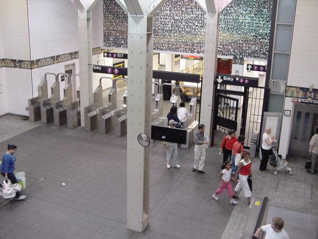 (61k, 640x480)<br><b>Country:</b> United States<br><b>City:</b> New York<br><b>System:</b> New York City Transit<br><b>Line:</b> IRT Flushing Line<br><b>Location:</b> Main Street/Flushing<br><b>Photo by:</b> Salaam Allah<br><b>Date:</b> 9/21/2002<br><b>Artwork:</b> <i>Happy World</i>, Ik-Joong Kang, 1998<br><b>Viewed (this week/total):</b> 10 / 8961
