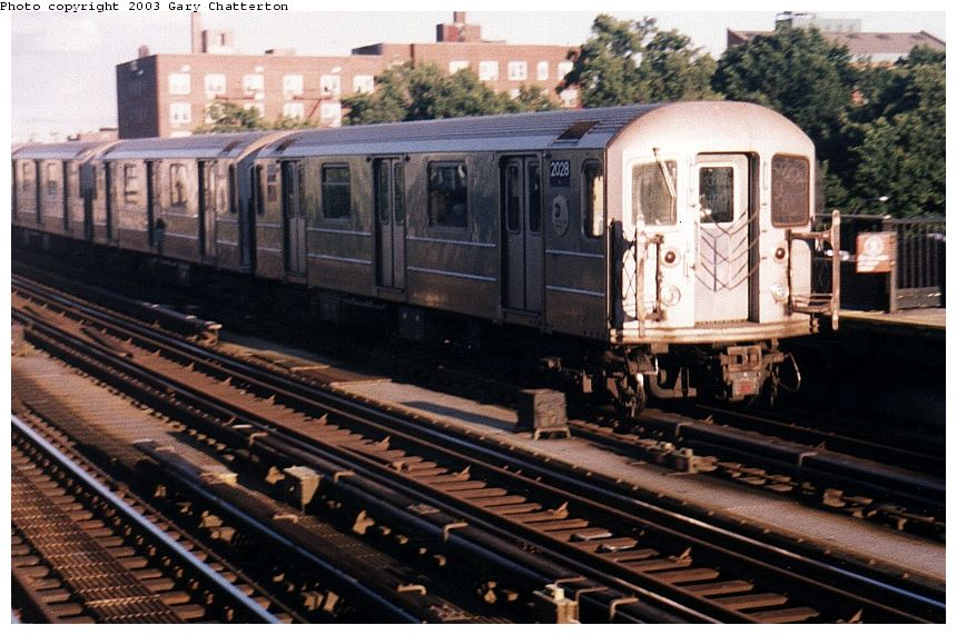 (108k, 860x571)<br><b>Country:</b> United States<br><b>City:</b> New York<br><b>System:</b> New York City Transit<br><b>Line:</b> IRT Flushing Line<br><b>Location:</b> 69th Street/Fisk Avenue<br><b>Route:</b> 7<br><b>Car:</b> R-62A (Bombardier, 1984-1987) 2028 <br><b>Photo by:</b> Gary Chatterton<br><b>Date:</b> 10/2/2003<br><b>Viewed (this week/total):</b> 0 / 3720