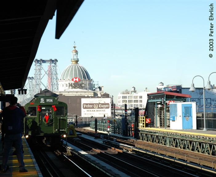 (154k, 702x576)<br><b>Country:</b> United States<br><b>City:</b> New York<br><b>System:</b> New York City Transit<br><b>Line:</b> BMT Nassau Street-Jamaica Line<br><b>Location:</b> Marcy Avenue<br><b>Route:</b> Fan Trip<br><b>Car:</b> R-1 (American Car & Foundry, 1930-1931) 100 <br><b>Photo by:</b> Peter Ehrlich<br><b>Date:</b> 12/28/2003<br><b>Viewed (this week/total):</b> 0 / 4445