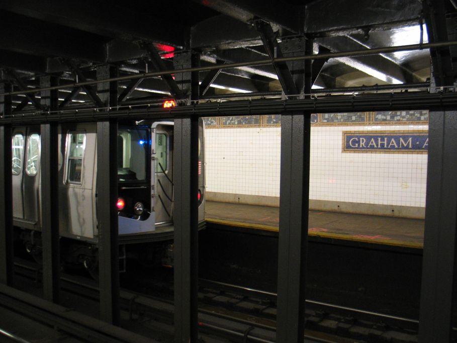 (83k, 909x682)<br><b>Country:</b> United States<br><b>City:</b> New York<br><b>System:</b> New York City Transit<br><b>Line:</b> BMT Canarsie Line<br><b>Location:</b> Graham Avenue<br><b>Route:</b> L<br><b>Car:</b> R-143 (Kawasaki, 2001-2002)  <br><b>Photo by:</b> Brian Weinberg<br><b>Date:</b> 3/10/2004<br><b>Viewed (this week/total):</b> 0 / 6370