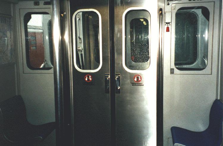 (61k, 750x490)<br><b>Country:</b> United States<br><b>City:</b> New York<br><b>System:</b> New York City Transit<br><b>Car:</b> R-110A (Kawasaki, 1992) Interior <br><b>Photo by:</b> Steve Kreisler<br><b>Date:</b> 1997<br><b>Notes:</b> Interior end door<br><b>Viewed (this week/total):</b> 0 / 8103