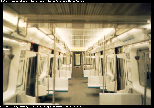 (38k, 540x379)<br><b>Country:</b> United States<br><b>City:</b> New York<br><b>System:</b> New York City Transit<br><b>Car:</b> R-110B (Bombardier, 1992) Interior <br><b>Photo by:</b> Jason R. DeCesare<br><b>Date:</b> 1997<br><b>Notes:</b> Interior, white color scheme<br><b>Viewed (this week/total):</b> 9 / 26667