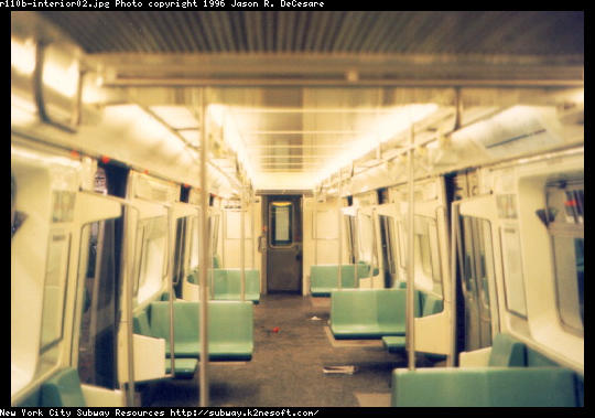 (41k, 540x379)<br><b>Country:</b> United States<br><b>City:</b> New York<br><b>System:</b> New York City Transit<br><b>Car:</b> R-110B (Bombardier, 1992) Interior <br><b>Photo by:</b> Jason R. DeCesare<br><b>Date:</b> 1997<br><b>Notes:</b> Interior, green color scheme<br><b>Viewed (this week/total):</b> 10 / 15421