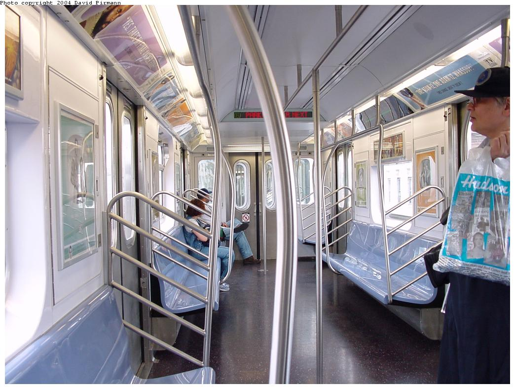 (137k, 1044x788)<br><b>Country:</b> United States<br><b>City:</b> New York<br><b>System:</b> New York City Transit<br><b>Car:</b> R-142 or R-142A (Number Unknown) Interior <br><b>Photo by:</b> David Pirmann<br><b>Date:</b> 7/29/2000<br><b>Notes:</b> Interior showing typical 'B' end<br><b>Viewed (this week/total):</b> 12 / 22700