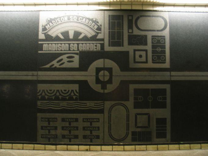 (43k, 682x511)<br><b>Country:</b> United States<br><b>City:</b> New York<br><b>System:</b> New York City Transit<br><b>Line:</b> IND Queens Boulevard Line<br><b>Location:</b> 50th Street<br><b>Photo by:</b> Brian Weinberg<br><b>Date:</b> 5/30/2004<br><b>Artwork:</b> <i>Untitled</i>, Matt Mullican, 1989<br><b>Notes:</b> Artwork on downtown side<br><b>Viewed (this week/total):</b> 0 / 3719