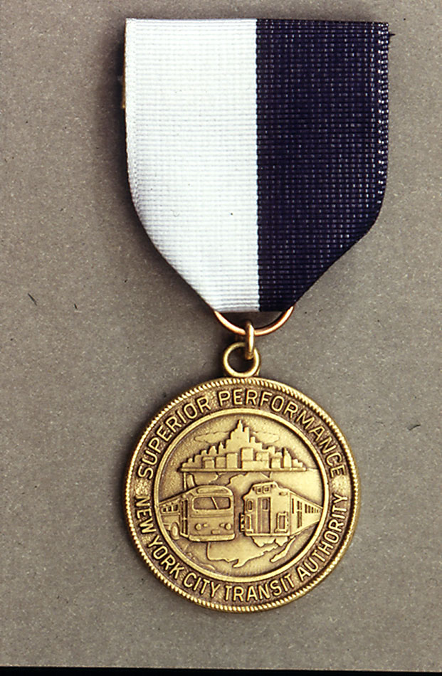 (165k, 621x950)<br><b>Country:</b> United States<br><b>City:</b> New York<br><b>System:</b> New York City Transit<br><b>Collection of:</b> George Cuhaj<br><b>Notes:</b> 1979 NYCTA Superior Performance award medal<br><b>Viewed (this week/total):</b> 3 / 6713