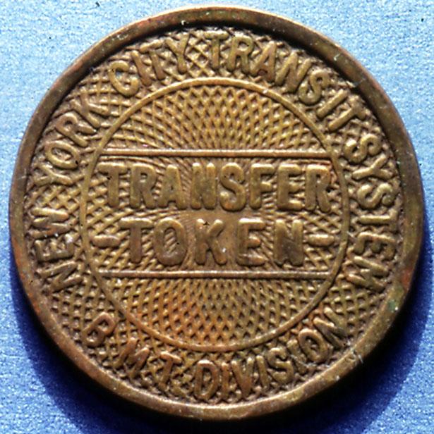 (137k, 615x616)<br><b>Country:</b> United States<br><b>City:</b> New York<br><b>System:</b> New York City Transit<br><b>Collection of:</b> George Cuhaj<br><b>Notes:</b> BMT Division transfer token, brass design, 1940; Obverse<br><b>Viewed (this week/total):</b> 3 / 6780
