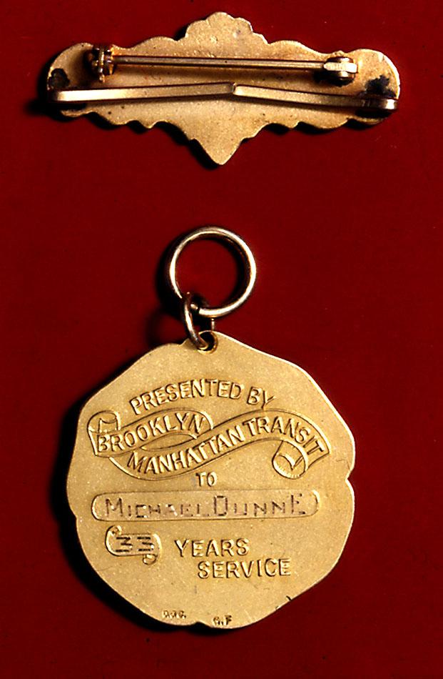 (118k, 621x950)<br><b>Country:</b> United States<br><b>City:</b> New York<br><b>System:</b> New York City Transit<br><b>Collection of:</b> George Cuhaj<br><b>Notes:</b> BMT retirement medal, 1920s; Reverse<br><b>Viewed (this week/total):</b> 4 / 5898