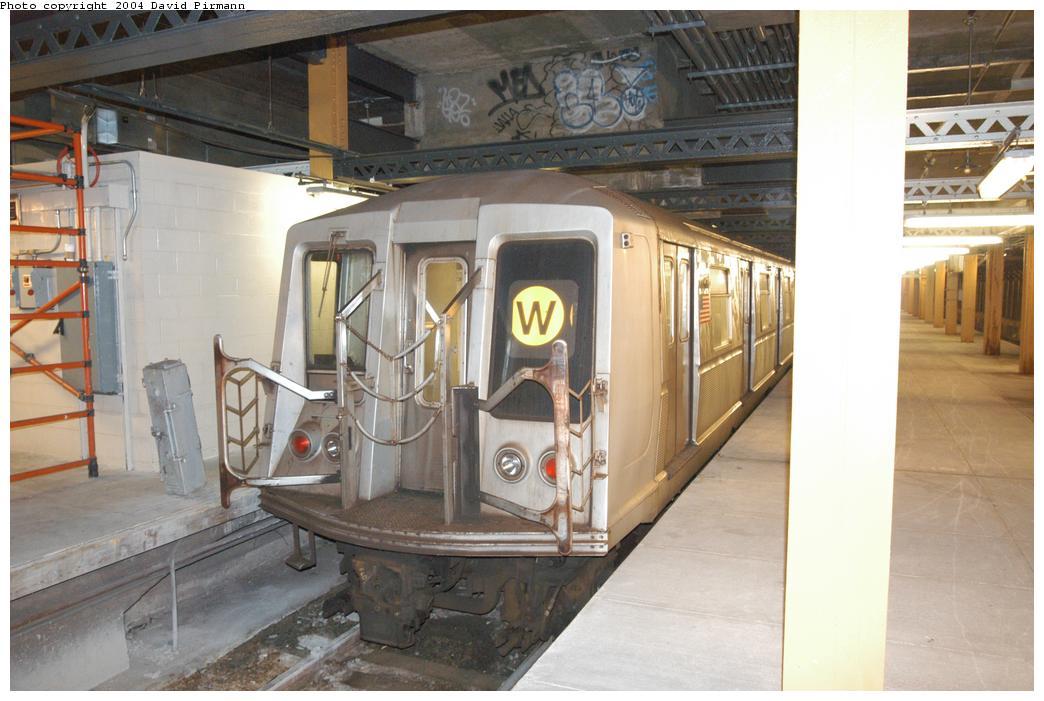 (145k, 1044x701)<br><b>Country:</b> United States<br><b>City:</b> New York<br><b>System:</b> New York City Transit<br><b>Line:</b> BMT Broadway Line<br><b>Location:</b> City Hall Lower Level<br><b>Car:</b> R-40 (St. Louis, 1968) 4404 <br><b>Photo by:</b> David Pirmann<br><b>Date:</b> 6/19/2004<br><b>Notes:</b> View of R40 laid up on middle trackway from east platform<br><b>Viewed (this week/total):</b> 2 / 16762