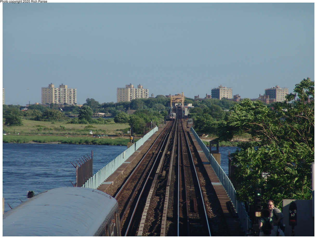 (428k, 1220x920)<br><b>Country:</b> United States<br><b>City:</b> New York<br><b>System:</b> New York City Transit<br><b>Line:</b> IND Rockaway Line<br><b>Location:</b> Broad Channel<br><b>Photo by:</b> Richard Panse<br><b>Date:</b> 6/19/2004<br><b>Notes:</b> View looking south from overpass in Broad Channel station; South Channel swing bridge in distance.<br><b>Viewed (this week/total):</b> 1 / 3137