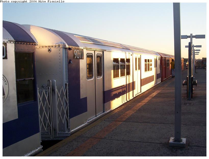 (68k, 820x624)<br><b>Country:</b> United States<br><b>City:</b> New York<br><b>System:</b> New York City Transit<br><b>Line:</b> IRT Flushing Line<br><b>Location:</b> Junction Boulevard<br><b>Route:</b> Fan Trip<br><b>Car:</b> R-33 Main Line (St. Louis, 1962-63) 9011 <br><b>Photo by:</b> Mike Fioriello<br><b>Date:</b> 6/19/2004<br><b>Viewed (this week/total):</b> 2 / 4454