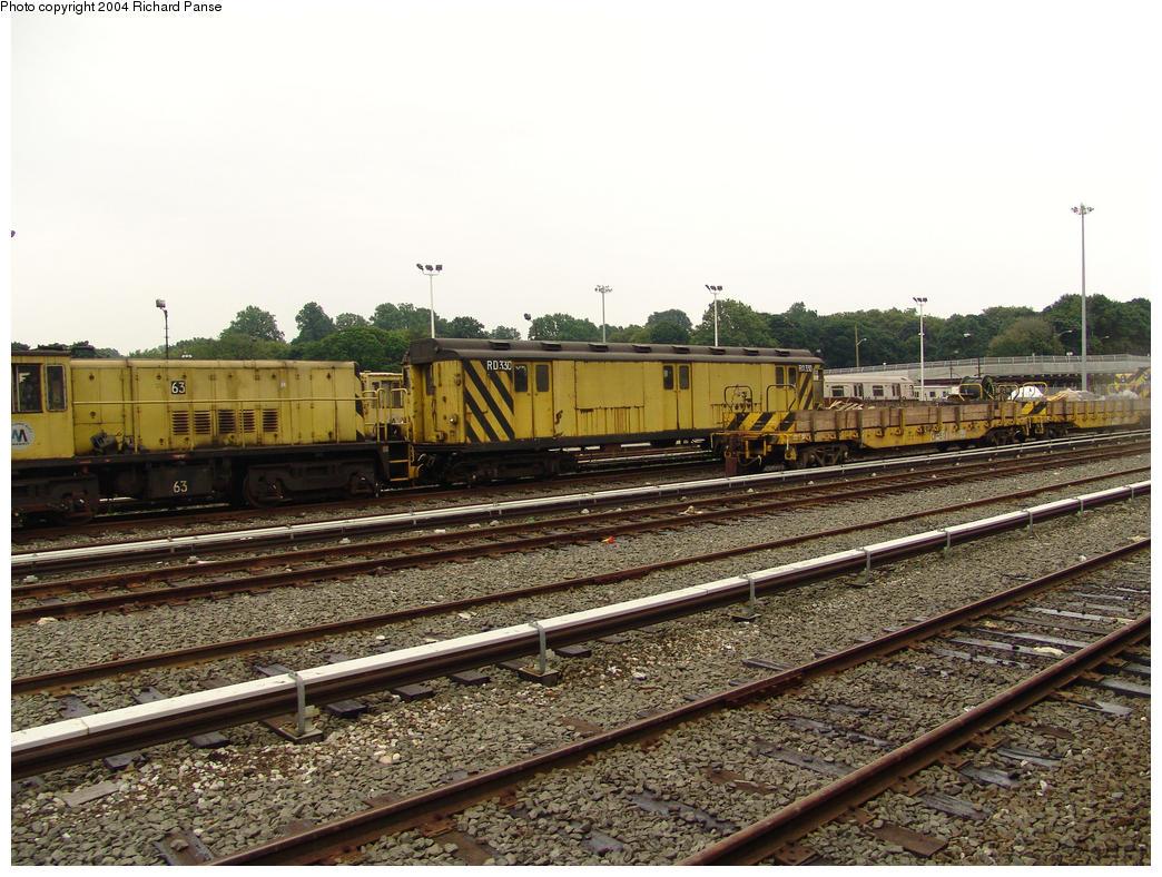(199k, 1044x788)<br><b>Country:</b> United States<br><b>City:</b> New York<br><b>System:</b> New York City Transit<br><b>Location:</b> 36th Street Yard<br><b>Car:</b> R-47 Locomotive 63 <br><b>Photo by:</b> Richard Panse<br><b>Date:</b> 7/18/2004<br><b>Notes:</b> With R14 RD330 (ex-5857)<br><b>Viewed (this week/total):</b> 1 / 3878