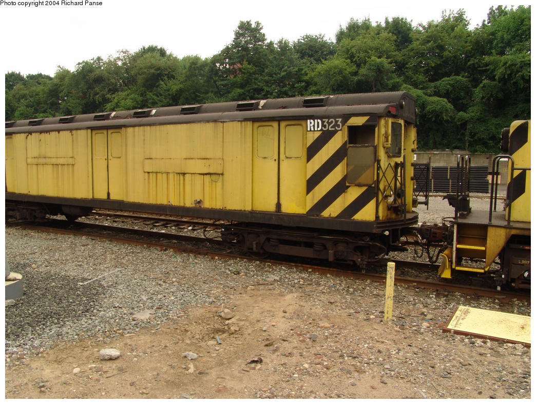 (214k, 1044x788)<br><b>Country:</b> United States<br><b>City:</b> New York<br><b>System:</b> New York City Transit<br><b>Location:</b> 36th Street Yard<br><b>Car:</b> R-71 Rider Car (R-17/R-21/R-22 Rebuilds) RD323 (ex-5877)<br><b>Photo by:</b> Richard Panse<br><b>Date:</b> 7/18/2004<br><b>Viewed (this week/total):</b> 0 / 3858
