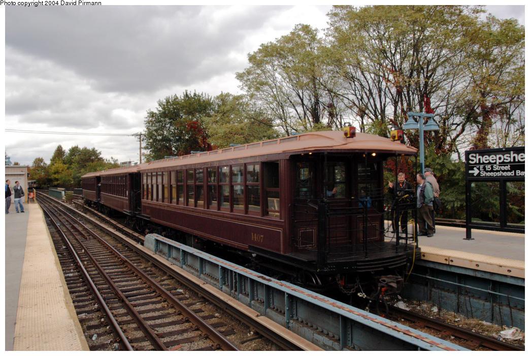 (217k, 1044x701)<br><b>Country:</b> United States<br><b>City:</b> New York<br><b>System:</b> New York City Transit<br><b>Line:</b> BMT Brighton Line<br><b>Location:</b> Sheepshead Bay<br><b>Route:</b> Fan Trip<br><b>Car:</b> BMT Elevated Gate Car 1407 <br><b>Photo by:</b> David Pirmann<br><b>Date:</b> 10/23/2004<br><b>Viewed (this week/total):</b> 3 / 4163