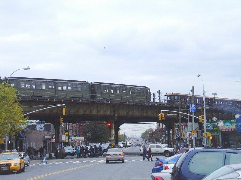 (88k, 800x600)<br><b>Country:</b> United States<br><b>City:</b> New York<br><b>System:</b> New York City Transit<br><b>Line:</b> BMT Brighton Line<br><b>Location:</b> Brighton Beach<br><b>Route:</b> Fan Trip<br><b>Photo by:</b> Fred Guenther<br><b>Date:</b> 10/23/2004<br><b>Notes:</b> Low-V train and BU train<br><b>Viewed (this week/total):</b> 0 / 4019