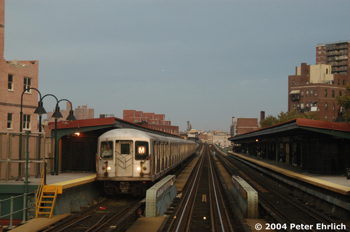 (126k, 720x478)<br><b>Country:</b> United States<br><b>City:</b> New York<br><b>System:</b> New York City Transit<br><b>Line:</b> BMT Nassau Street-Jamaica Line<br><b>Location:</b> Lorimer Street<br><b>Route:</b> M<br><b>Car:</b> R-42 (St. Louis, 1969-1970) 4566 <br><b>Photo by:</b> Peter Ehrlich<br><b>Date:</b> 10/27/2004<br><b>Viewed (this week/total):</b> 2 / 4476