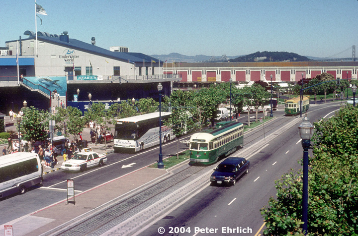 (204k, 720x476)<br><b>Country:</b> United States<br><b>City:</b> San Francisco/Bay Area, CA<br><b>System:</b> SF MUNI<br><b>Location:</b> Embarcadero/Pier 39<br><b>Car:</b> SF MUNI PCC (Ex-SEPTA) (St. Louis Car Co., 1947-1948) 1058 <br><b>Photo by:</b> Peter Ehrlich<br><b>Date:</b> 6/14/2000<br><b>Viewed (this week/total):</b> 2 / 991