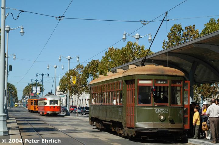 (169k, 720x478)<br><b>Country:</b> United States<br><b>City:</b> San Francisco/Bay Area, CA<br><b>System:</b> SF MUNI<br><b>Location:</b> Embarcadero/Ferry Building<br><b>Car:</b> New Orleans Public Service (Perley A. Thomas Car Works, 1924) 952 <br><b>Photo by:</b> Peter Ehrlich<br><b>Date:</b> 10/9/2004<br><b>Notes:</b> With PCC 1059 (Boston) and a Milan car ahead of 952.<br><b>Viewed (this week/total):</b> 1 / 874