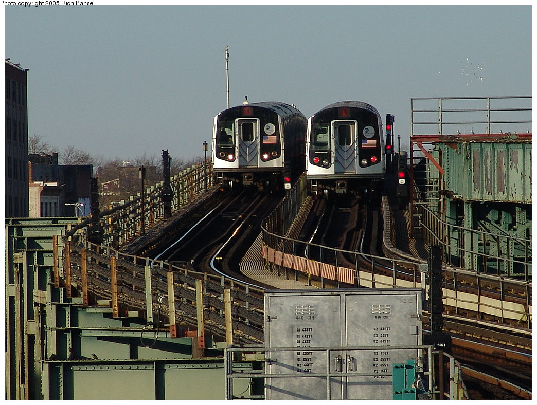(241k, 1044x788)<br><b>Country:</b> United States<br><b>City:</b> New York<br><b>System:</b> New York City Transit<br><b>Line:</b> BMT Canarsie Line<br><b>Location:</b> Atlantic Avenue<br><b>Route:</b> L<br><b>Car:</b> R-143 (Kawasaki, 2001-2002)  <br><b>Photo by:</b> Richard Panse<br><b>Date:</b> 1/1/2005<br><b>Notes:</b> View from Sutter Ave. of two trains parallel at Atlantic Ave.-- showing new alignment of Canarsie line tracks.<br><b>Viewed (this week/total):</b> 5 / 7766