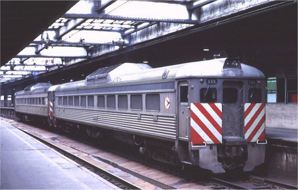 (148k, 1024x651)<br><b>Country:</b> United States<br><b>City:</b> Newark, NJ<br><b>System:</b> Northeast Corridor (NJ) (Amtrak/NJTransit)<br><b>Line:</b> Northeast Corridor<br><b>Location:</b> Penn Station-Newark<br><b>Car:</b>  555 <br><b>Photo by:</b> Ed McKernan<br><b>Collection of:</b> Joe Testagrose<br><b>Date:</b> 2/1975<br><b>Viewed (this week/total):</b> 1 / 3749