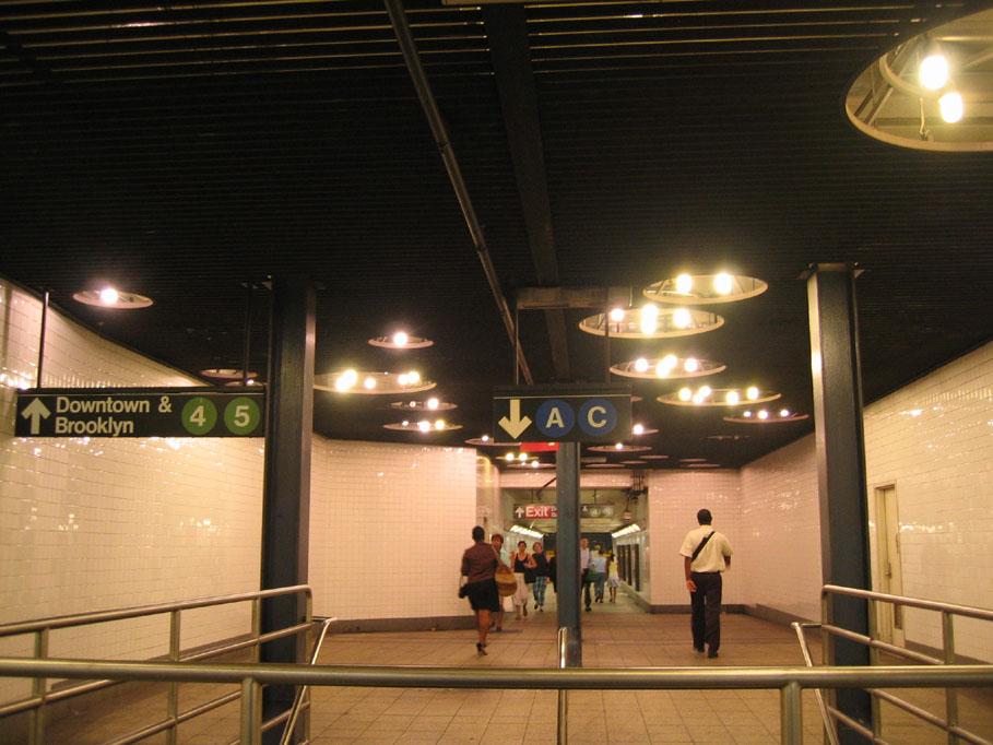 (131k, 909x682)<br><b>Country:</b> United States<br><b>City:</b> New York<br><b>System:</b> New York City Transit<br><b>Line:</b> IND 8th Avenue Line<br><b>Location:</b> Fulton Street (Broadway/Nassau)<br><b>Photo by:</b> Robbie Rosenfeld<br><b>Date:</b> 7/14/2005<br><b>Artwork:</b> <i>Astral Grating</i>, Nancy Holt, 1987<br><b>Viewed (this week/total):</b> 2 / 6075