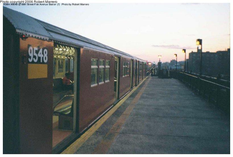 (70k, 820x553)<br><b>Country:</b> United States<br><b>City:</b> New York<br><b>System:</b> New York City Transit<br><b>Line:</b> IRT Flushing Line<br><b>Location:</b> 69th Street/Fisk Avenue<br><b>Route:</b> 7<br><b>Car:</b> R-36 Main Line (St. Louis, 1964) 9548 <br><b>Photo by:</b> Robert Marrero<br><b>Date:</b> 12/2000<br><b>Viewed (this week/total):</b> 0 / 5829