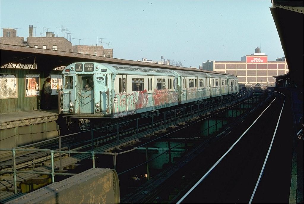 (203k, 1024x689)<br><b>Country:</b> United States<br><b>City:</b> New York<br><b>System:</b> New York City Transit<br><b>Line:</b> BMT Nassau Street-Jamaica Line<br><b>Location:</b> Sutphin Boulevard (Demolished)<br><b>Route:</b> Fan Trip<br><b>Car:</b> R-33 World's Fair (St. Louis, 1963-64) 9333 <br><b>Photo by:</b> Doug Grotjahn<br><b>Collection of:</b> Joe Testagrose<br><b>Date:</b> 11/27/1976<br><b>Viewed (this week/total):</b> 4 / 5612