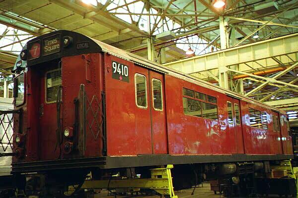 (129k, 600x400)<br><b>Country:</b> United States<br><b>City:</b> New York<br><b>System:</b> New York City Transit<br><b>Location:</b> Coney Island Shop/Overhaul & Repair Shop<br><b>Car:</b> R-36 World's Fair (St. Louis, 1963-64) 9410 <br><b>Photo by:</b> Sidney Keyles<br><b>Date:</b> 5/22/1999<br><b>Notes:</b> Mate is outside on museum track<br><b>Viewed (this week/total):</b> 0 / 7809