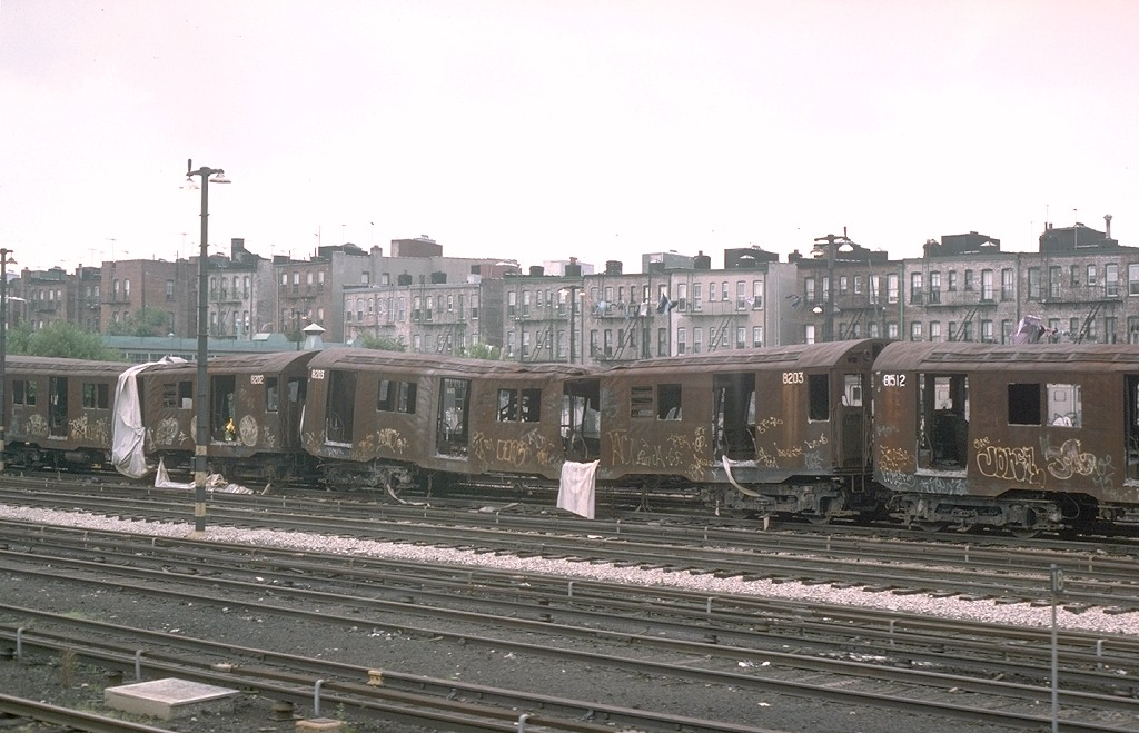 (178k, 1024x659)<br><b>Country:</b> United States<br><b>City:</b> New York<br><b>System:</b> New York City Transit<br><b>Location:</b> Fresh Pond Yard<br><b>Car:</b> R-27 (St. Louis, 1960) 8203 <br><b>Photo by:</b> Joe Testagrose<br><b>Date:</b> 7/4/1976<br><b>Notes:</b> Result of a fire at Fresh Pond station.<br><b>Viewed (this week/total):</b> 1 / 6574