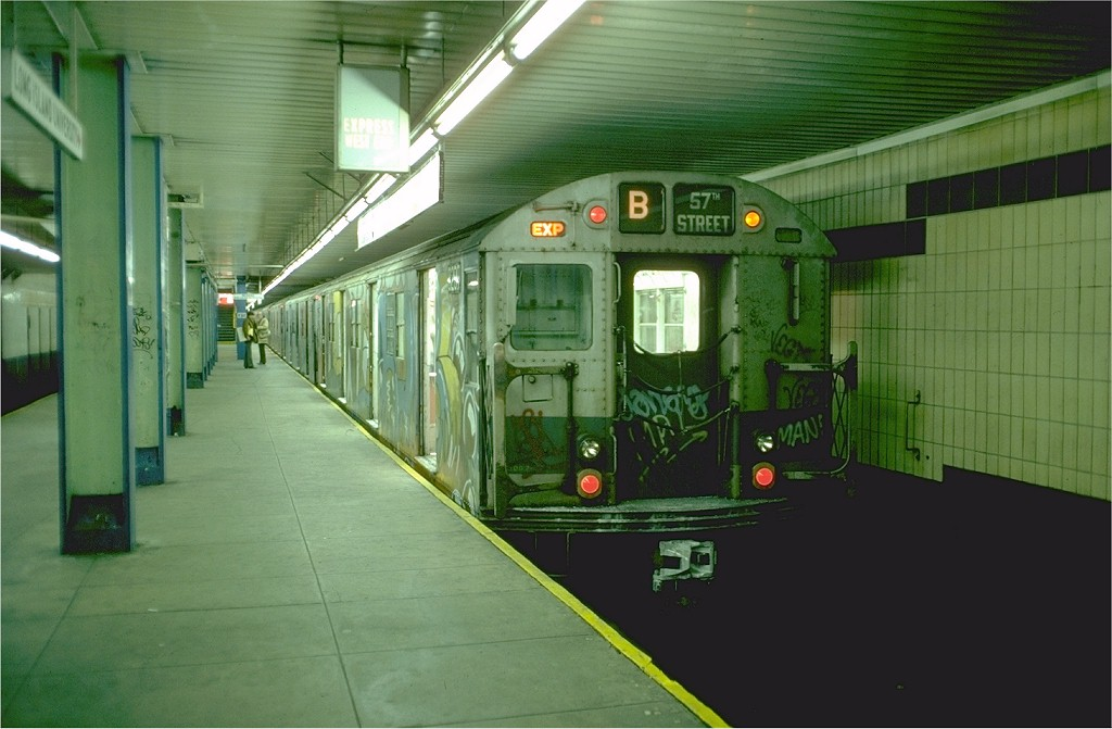 (160k, 1024x671)<br><b>Country:</b> United States<br><b>City:</b> New York<br><b>System:</b> New York City Transit<br><b>Line:</b> BMT 4th Avenue Line<br><b>Location:</b> DeKalb Avenue<br><b>Route:</b> B<br><b>Car:</b> R-27 (St. Louis, 1960) 8209 <br><b>Photo by:</b> Doug Grotjahn<br><b>Collection of:</b> Joe Testagrose<br><b>Date:</b> 12/5/1976<br><b>Viewed (this week/total):</b> 0 / 7077