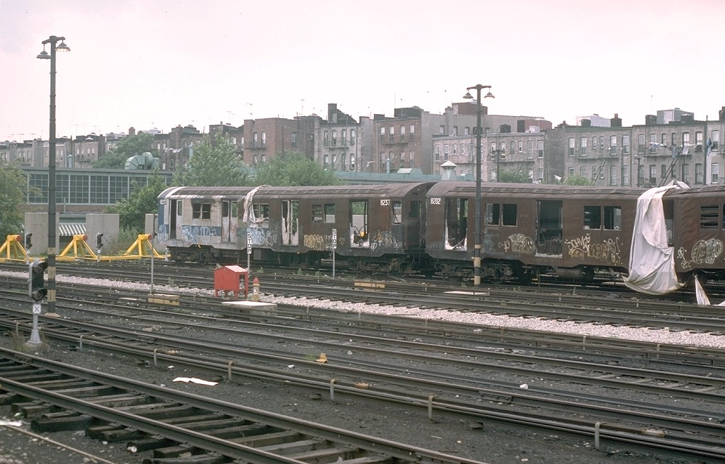 (198k, 1024x655)<br><b>Country:</b> United States<br><b>City:</b> New York<br><b>System:</b> New York City Transit<br><b>Location:</b> Fresh Pond Yard<br><b>Car:</b> R-27 (St. Louis, 1960) 8237 <br><b>Photo by:</b> Joe Testagrose<br><b>Date:</b> 7/4/1976<br><b>Notes:</b> Result of a fire at Metropolitan Avenue<br><b>Viewed (this week/total):</b> 0 / 11961