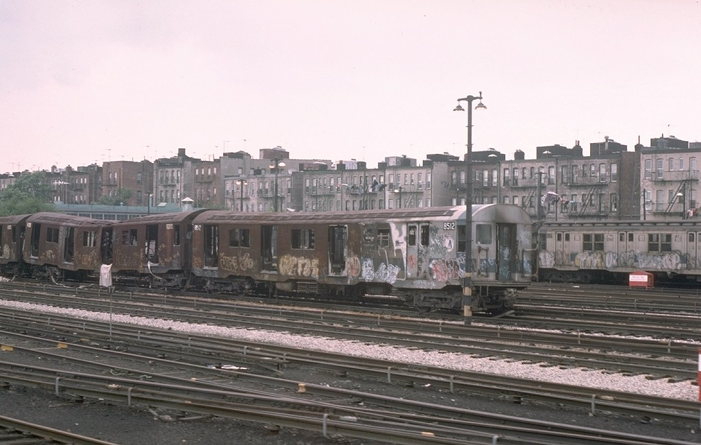 (166k, 1024x650)<br><b>Country:</b> United States<br><b>City:</b> New York<br><b>System:</b> New York City Transit<br><b>Location:</b> Fresh Pond Yard<br><b>Car:</b> R-30 (St. Louis, 1961) 8512 <br><b>Photo by:</b> Joe Testagrose<br><b>Date:</b> 7/4/1976<br><b>Notes:</b> Result of a fire at Metropolitan Avenue<br><b>Viewed (this week/total):</b> 0 / 12791