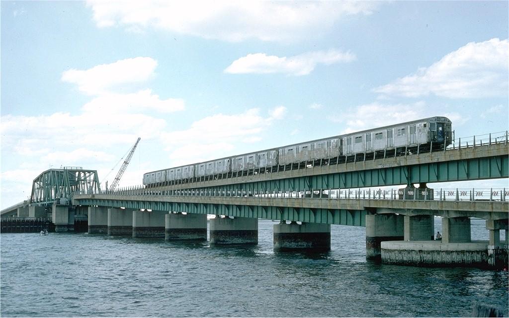 (182k, 1024x641)<br><b>Country:</b> United States<br><b>City:</b> New York<br><b>System:</b> New York City Transit<br><b>Line:</b> IND Rockaway Line<br><b>Location:</b> South Channel Bridge<br><b>Car:</b> R-32 (Budd, 1964) 3595 <br><b>Collection of:</b> Joe Testagrose<br><b>Date:</b> 6/19/1977<br><b>Viewed (this week/total):</b> 0 / 6029